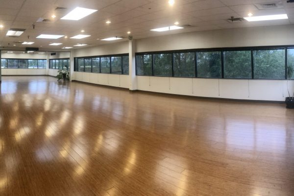 "1265 ft² — A crown jewel of the HUH Institute, the Infinity Room spans the western wing, offers incredible panoramic views of the mountains, and overlooks our community gardens.  A glass composite partition is removable to combine this room with the Horizon Room, and create ""Infinite Space."""